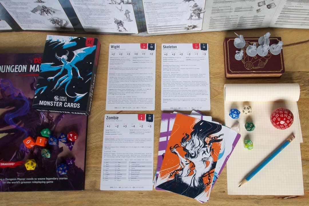 Table with 5E Dungeon Master Screen and Monster Cards